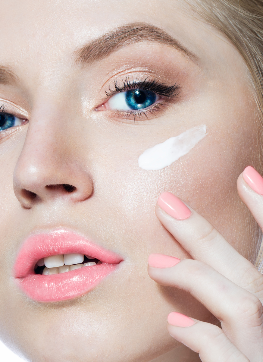 Woman face with cream